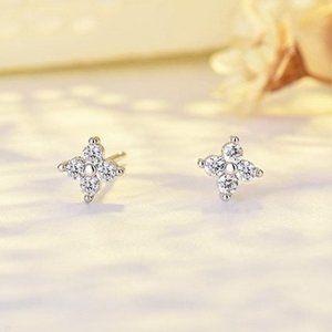 Gold small 4 petals CZ diamonds studs